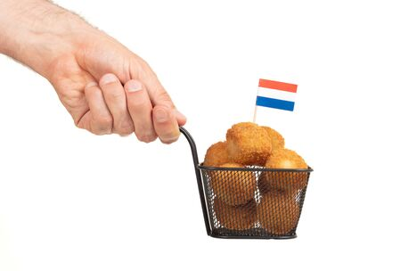 Basket of dutch traditional snack bitterbal with a dutch flag, isolated