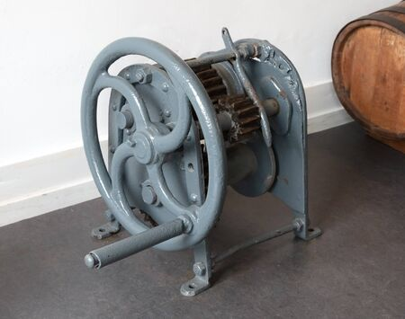 Old vintage metal winch standing on the ground