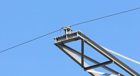 High-voltage electricity pylon against blue sky, the Netherlands Standard-Bild