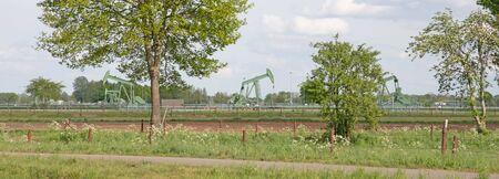 Landscape with oil pump jack, west germany