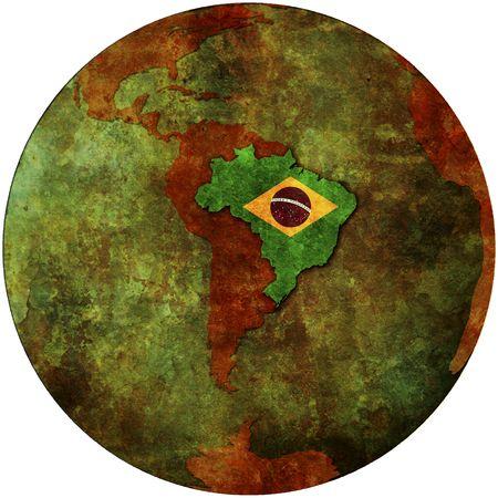 brazil flag on map of earth globe photo