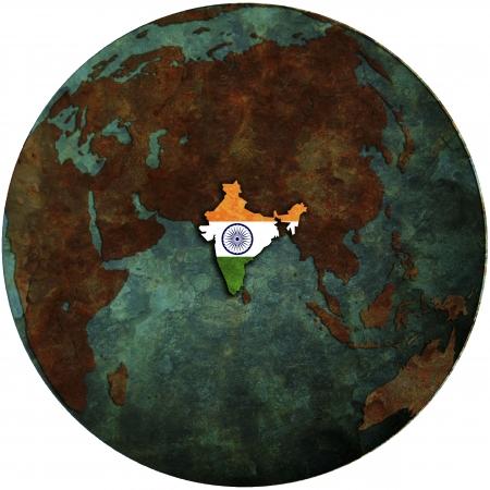 india flag on map of earth globe photo