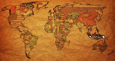 old political map of world with flag of indonesia photo
