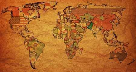 old political map of world with flag of pakistan photo