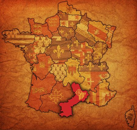 Languedoc-Roussillon on old map of france with flags of administrative divisions photo
