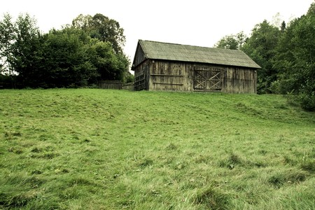 old wood vintage barn on a hill with grass in village museum Stock Photo - 7859271