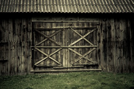 detail of wooden barn door in a village museum