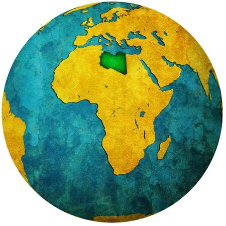 libya territory with flag on map of globe photo