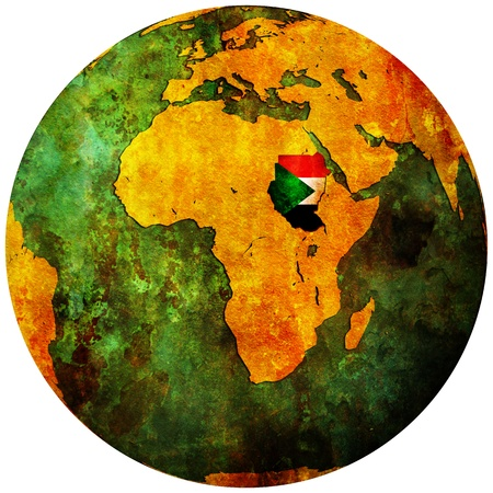 sudan territory with flag on map of globe photo