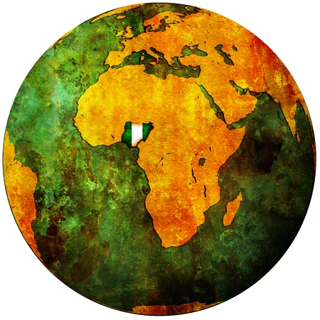 nigeria territory with flag on map of globe photo