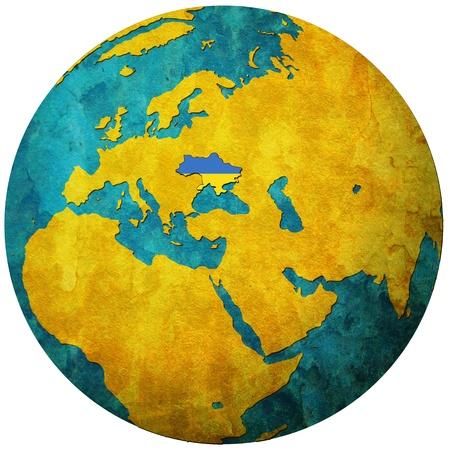 ukraine territory with flag on map of globe photo