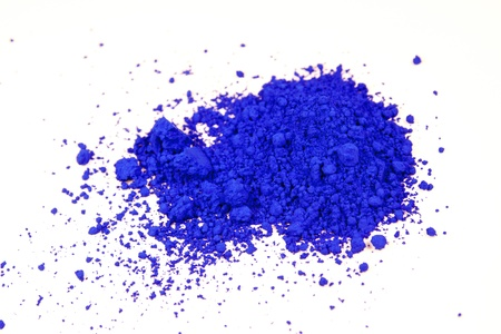 pigment: close up of a small portion of ultramarine blue pigment isolated over white
