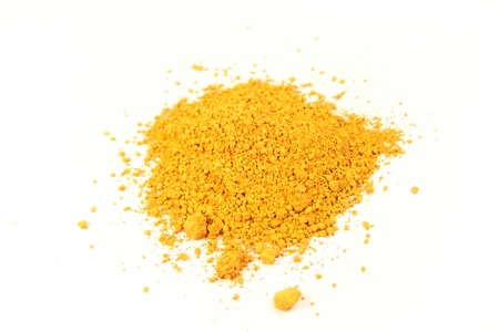pigment: close up of a small portion of french ocher pigment isolated over white