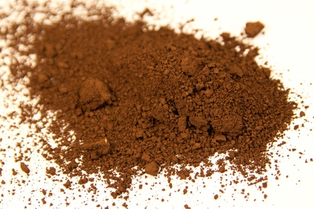 umber: close up of a small portion of burnt umber pigment isolated over white Stock Photo