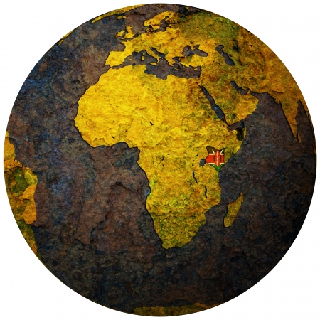 orthographic: kenya territory with flag on map of globe