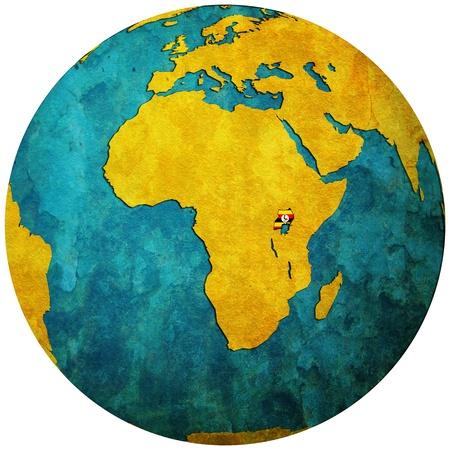 uganda territory with flag on map of globe 写真素材