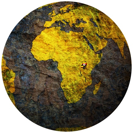 uganda territory with flag on map of globe photo