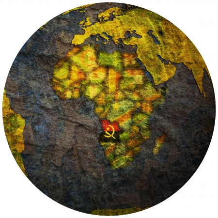 angola territory with flag on map of globe photo