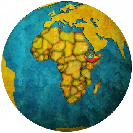 ethiopia territory with flag on map of globe photo
