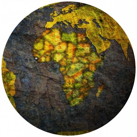 sierra leone territory with flag on map of globe photo