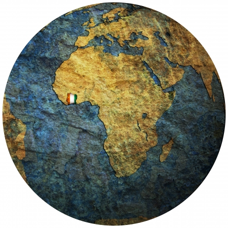 ivory coast territory with flag on map of globe photo