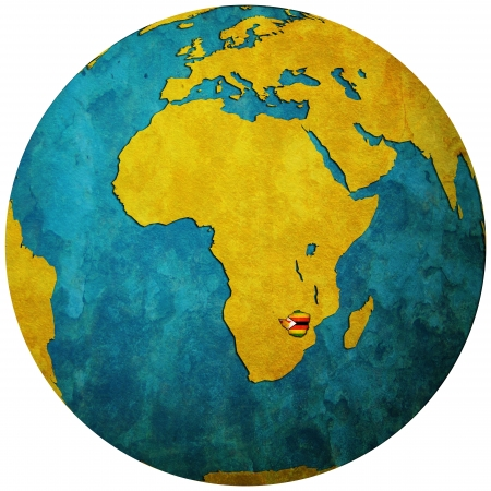 zimbabwe territory with flag on map of globe photo
