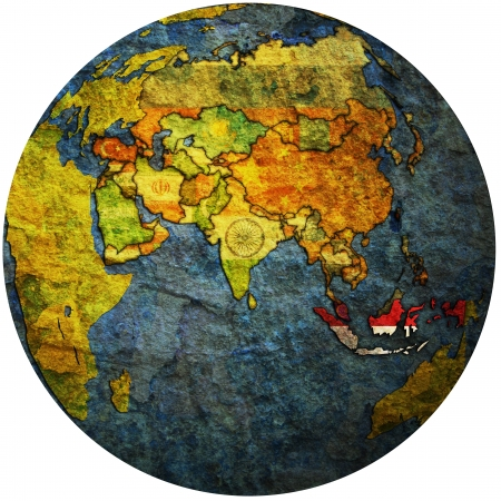 isolated over white territory of indonesia with flag on globe map photo