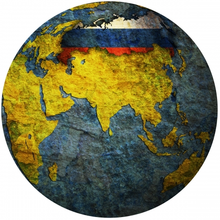 isolated over white territory of russia with flag on globe map photo