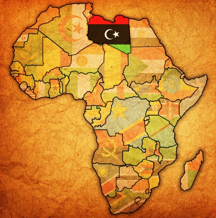 libya on actual vintage political map of africa with flags photo