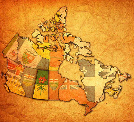 Saskatchewan on administration map of canada with flags photo