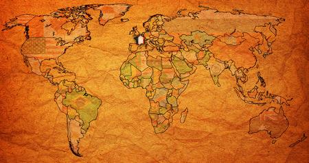 vintage world map: france flag on old vintage world map with national borders