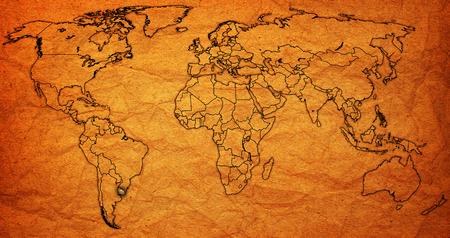 bandera de uruguay: uruguay flag on old vintage world map with national borders Foto de archivo
