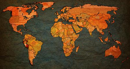 vintage world map: peru flag on old vintage world map with national borders