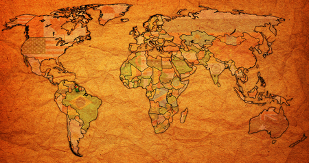 vintage world map: guyana flag on old vintage world map with national borders Stock Photo