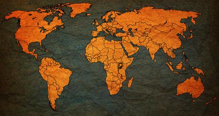 vintage world map: uganda flag on old vintage world map with national borders