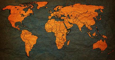 vintage world map: somalia flag on old vintage world map with national borders