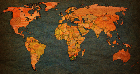 world flag: south africa flag on old vintage world map with national borders