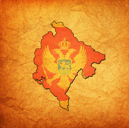 national borders: map with flag of montenegro with national borders Stock Photo