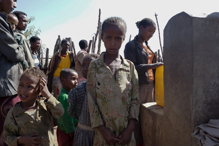 potable: kids in ethiopia near faucet with potable water