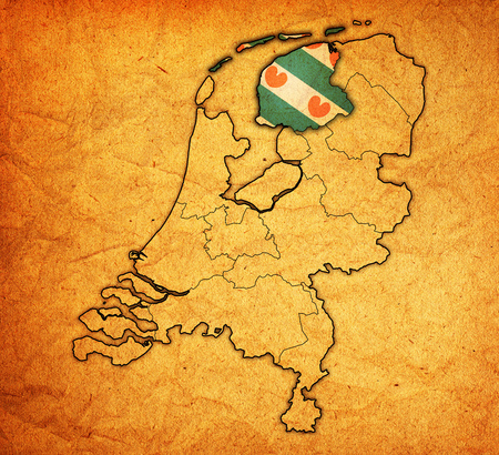 provinces: friesland flag on map with borders of provinces in netherlands
