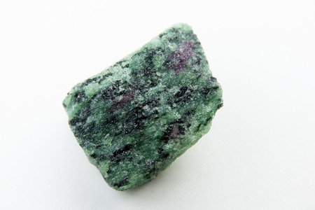 macro photo of ruby inside of zoisite isolated over white
