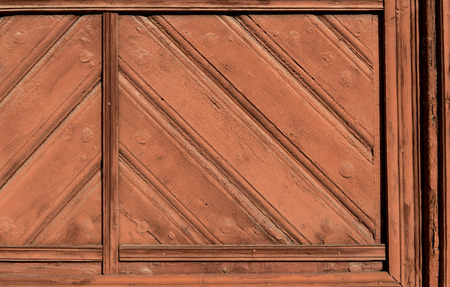 detail of old wooden doors painted with oil paint