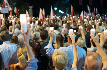 crowd with candles and flags on demonstration  against destroying of supreme court by polish government. Lublin, Poland. 22 july 2017