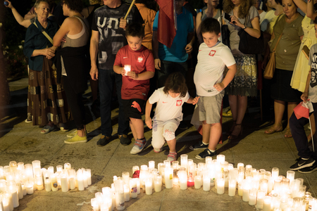 kids with t-shirt with polish emblems on demonstration called candle light revolution. People protests against destroying of supreme court by government. Lublin, Poland. 22 july 2017 Editorial