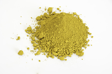 extreme close up of yellow pigment isolated over white background Stock Photo