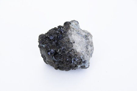 extreme close up of Andradite mineral isolated over white background in focus stacking technique