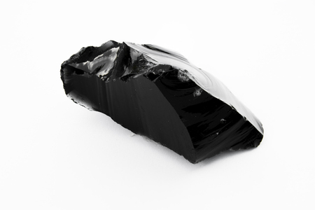 extreme close up of Obsidian mineral isolated over white background Stock Photo