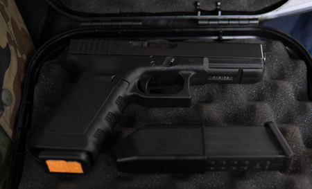glock with ammo clip inside of a black case