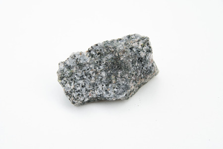 extreme close up with a lot of details of quartz diorite mineral isolated over white background