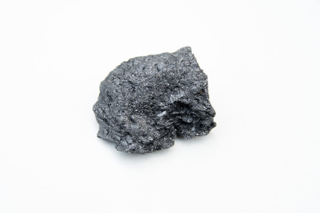 extreme close up with a lot of details of graphite mineral isolated over white background Stok Fotoğraf - 100860547